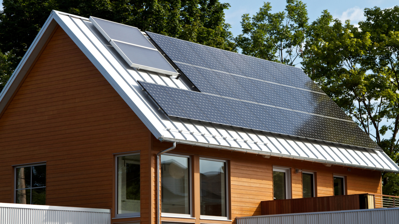 Green house with solar panels, Portland, Maine